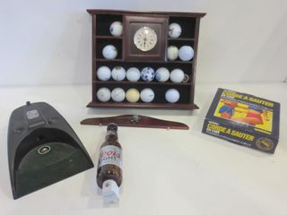 ClOCK DISPlAY SHElF WITH COllECTION OF GOlF BAllS