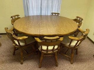 Wooden dining room table with 2 leaves and 6