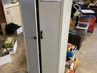 Metal storage container with doors