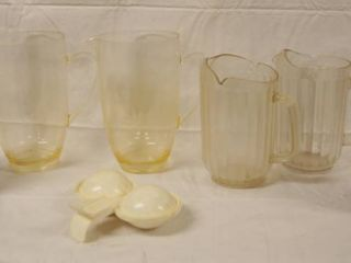 lot of Kitchen Items   2 Napkin Holders  4 Plastic Serving Pitchers  and a Microwave Egg Maker