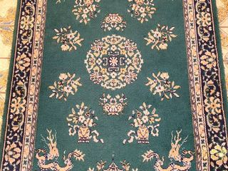 Green patterned rug  4 x 6 feet