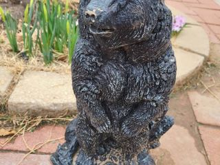 Black concrete bear nineteen inches tall