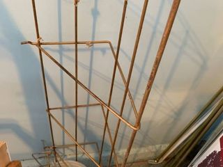 Metal shelf and pegboard pegs