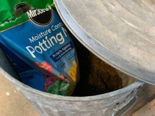 Garbage pail of potting soil