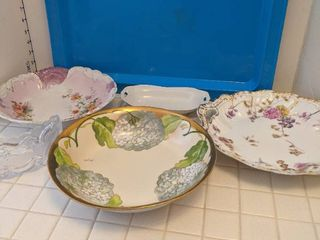 Decorative serving bowls and blue serving tray