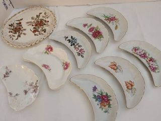 Variety of crescent dishes and small platter