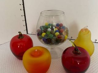 Glass fruit and marbles