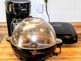 Sunbeam Coffee Maker  West Bend Stir Crazy Corn Popper   George Foreman Grill   All Powered On