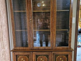 lighted China Cabinet Accented with Detail of Wire in Glass Side Doors
