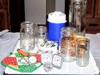 Assorted Kitchen Wares lot  Metal Enamel Wares Tray  Jars and lids  Fridge and Meat Thermometer  Brand New Coleman Travel Jug  Glass Cannister  Picture Magnet  Vtg Pot Holders and More