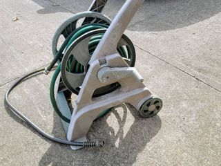 Ames ReelEasy Hose Reel Cart with hose and nozzle