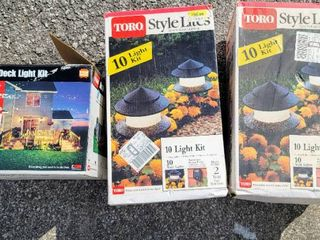 2  Boxes of Toro Style lites Outdoor lighting and  1  Box Toro Deck light Kit