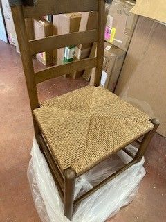 2 wooden chairs with wicker seat