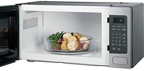 GE PEM31SFSS Profile 1 1 Cu  Ft  Countertop Microwave  Refurbished   Retail  300 99