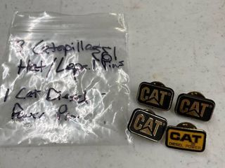 3 Caterpillar hat and lapel pins and 1 CAT diesel power pin