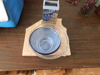 cutting board   cheese grater   glass bowl