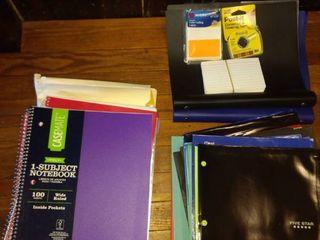 lot of school supplies notebooks paper folders etc