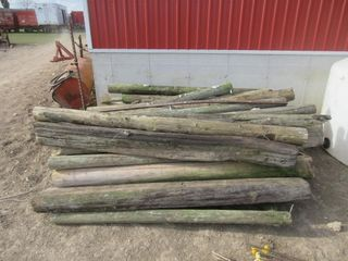lOT  WOODEN FENCE POSTS