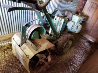 large Rear Tine Counter Rotating Tiller   No ran in several years   Motor turns over and has compression   tires hold air
