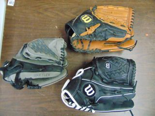 2 Wilson and 1 Mizuno Ball Gloves