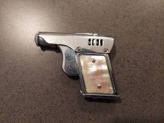 lighter Made in Occupied Japan   Grips Appear to be Mother of Pearl but 1 is Broke