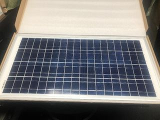 New in box solar panel