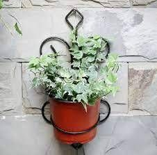 Colt Cast on Crest Wall Planter Stand