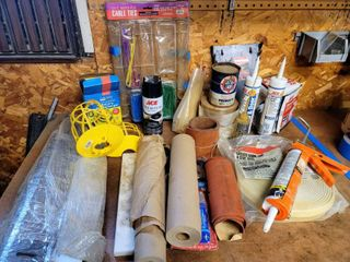 large lot of Garage and Home Improvement   Tapes  Zip Ties  Silicone Caulk  Garage Door Sealing Strip   more