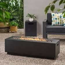 Wellington fire pit with lava rocks by Christopher knight
