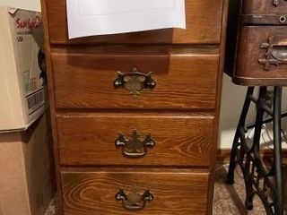Wooden four drawer sewing cabinet with sewing