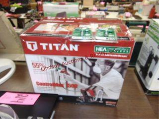 NIB Ttitan airless paint sprayer   2 NIP tips