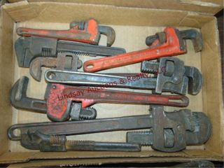 Flat of various size pipe wrenches