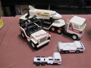 4 NASA trucks