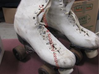 Pair of roller skates  size unknown