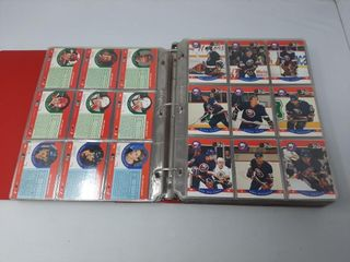 Assortment Of Hockey Cards In Binders