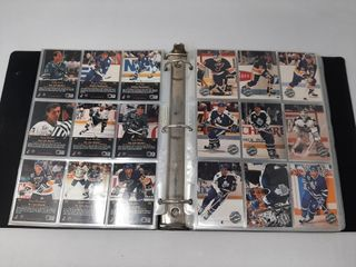 Assortment Of Hockey And Baseball Cards In Binders