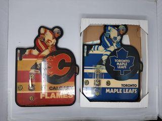 Calgary flames clock and Toronto maple leafs clock