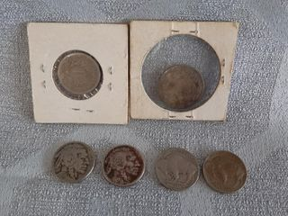 5 Cents American Currency And 25 Cents Canadian