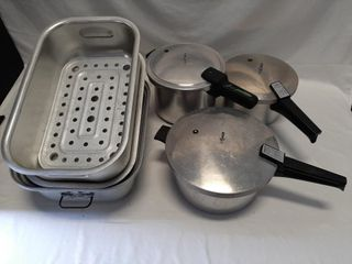 Trio Of Pressure Cookers And Buffet Serving Trays