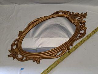 Famed wall mirror
