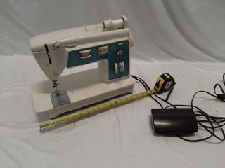 Singer sewing machine with pedal