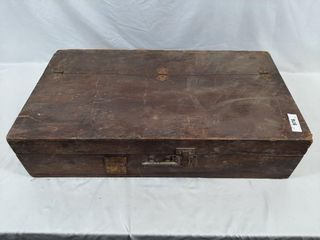 Antique wooden tool box with tape and sandpaper