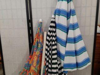 Trio of umbrellas  tallest is 59