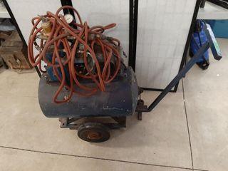 Air compressor on wheels  tank is 27  x 14
