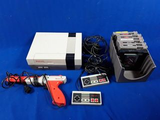 Nintendo system with 2 controllers  gun and 7
