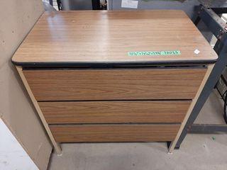 Press board and sheet metal three drawer dresser