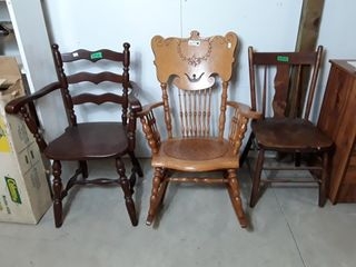 Three wooden chairs  1 is a rocking chair