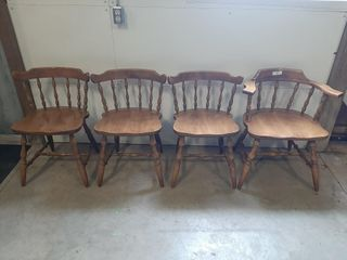 One wooden captains chair and three regular