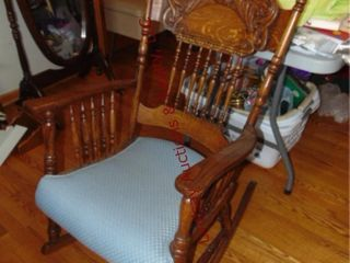 Wood rocking chair that has been reupholstered