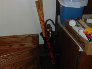 Metal cane holder w  canes  yard stick   other